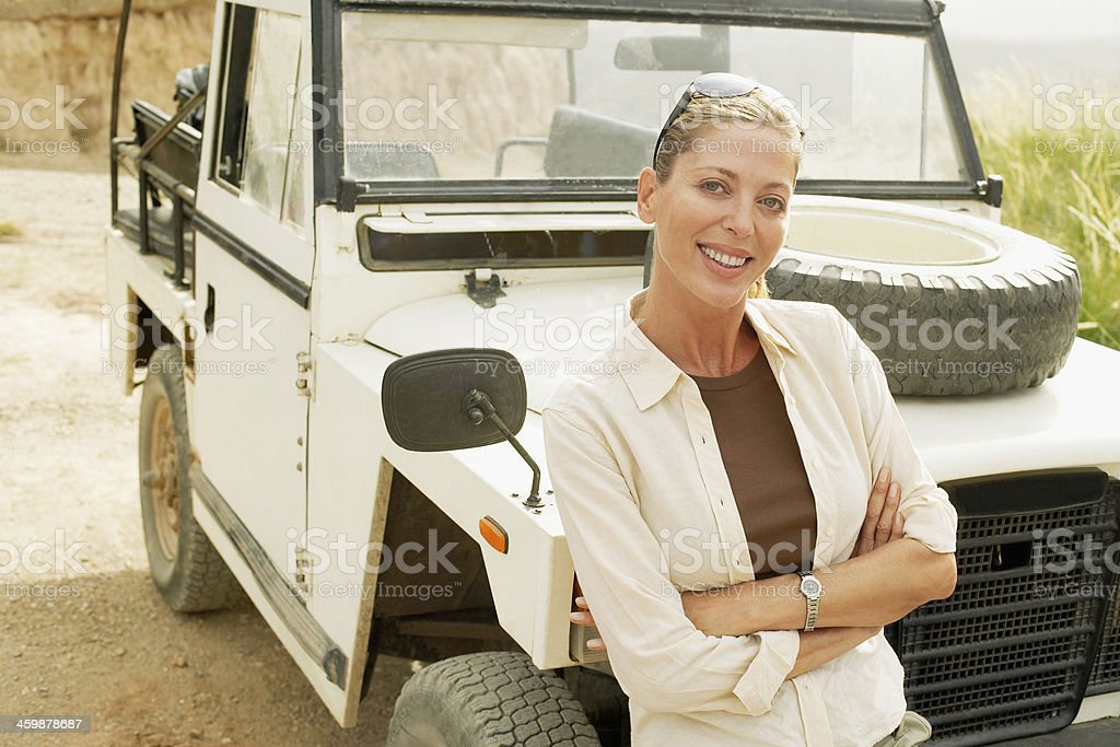 Happy Woman Standing In Front Of Car royalty-free stock photo