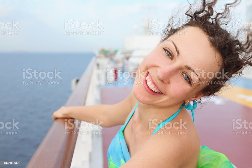 A happy woman standing on the cruise decking royalty-free stock photo