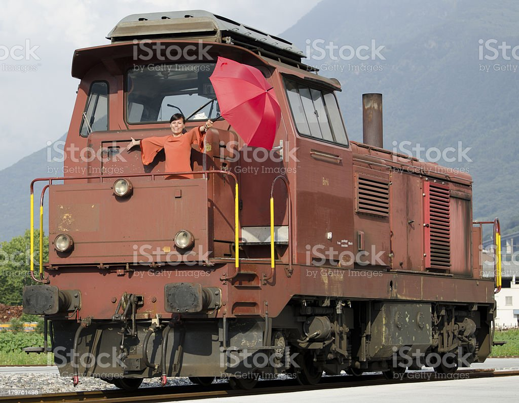 Happy woman standing on train royalty-free stock photo