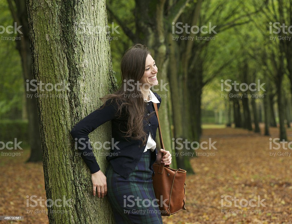 Happy woman standing outdoors and relaxing on a autumn day royalty-free stock photo