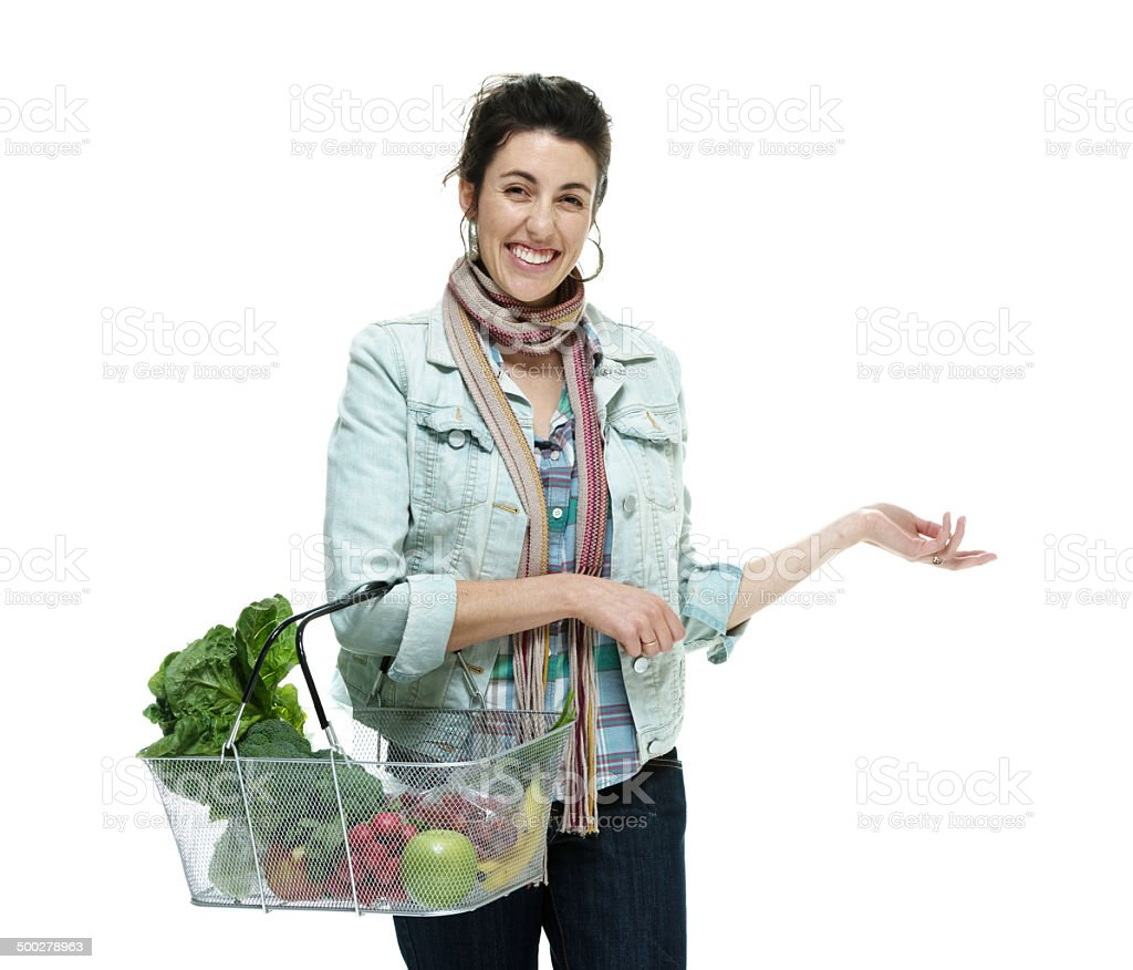 Happy woman standing with shopping basket royalty-free stock photo
