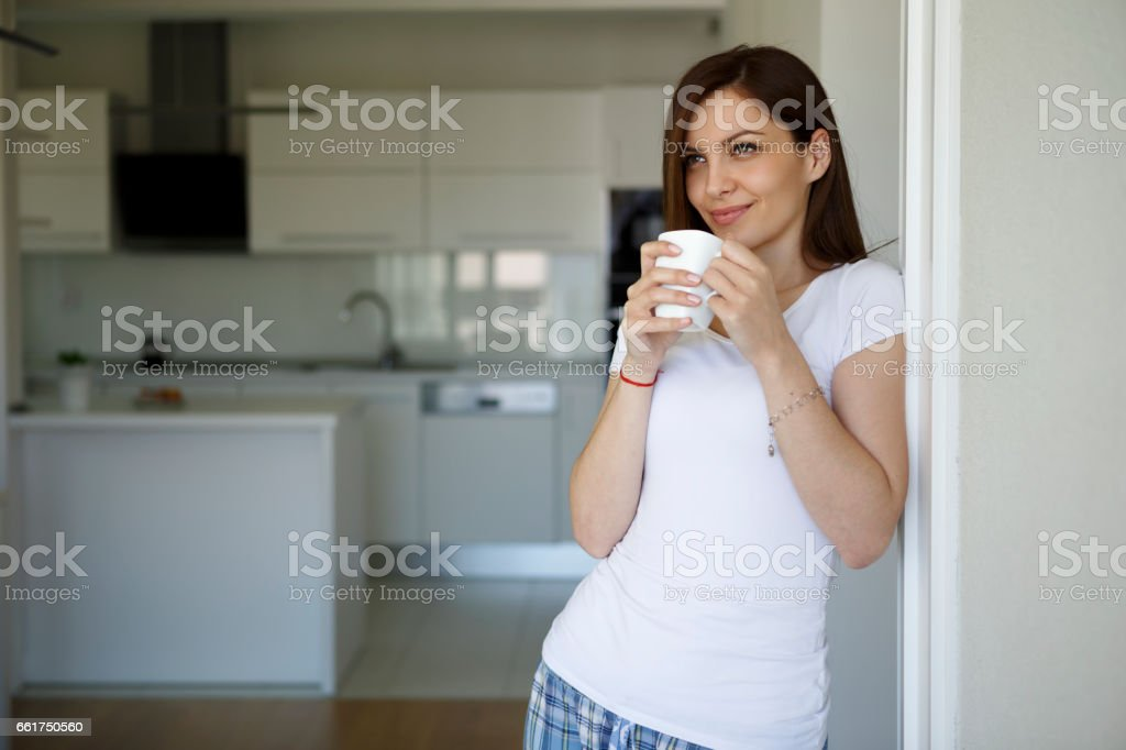 Happy woman starting a day with coffee stock photo