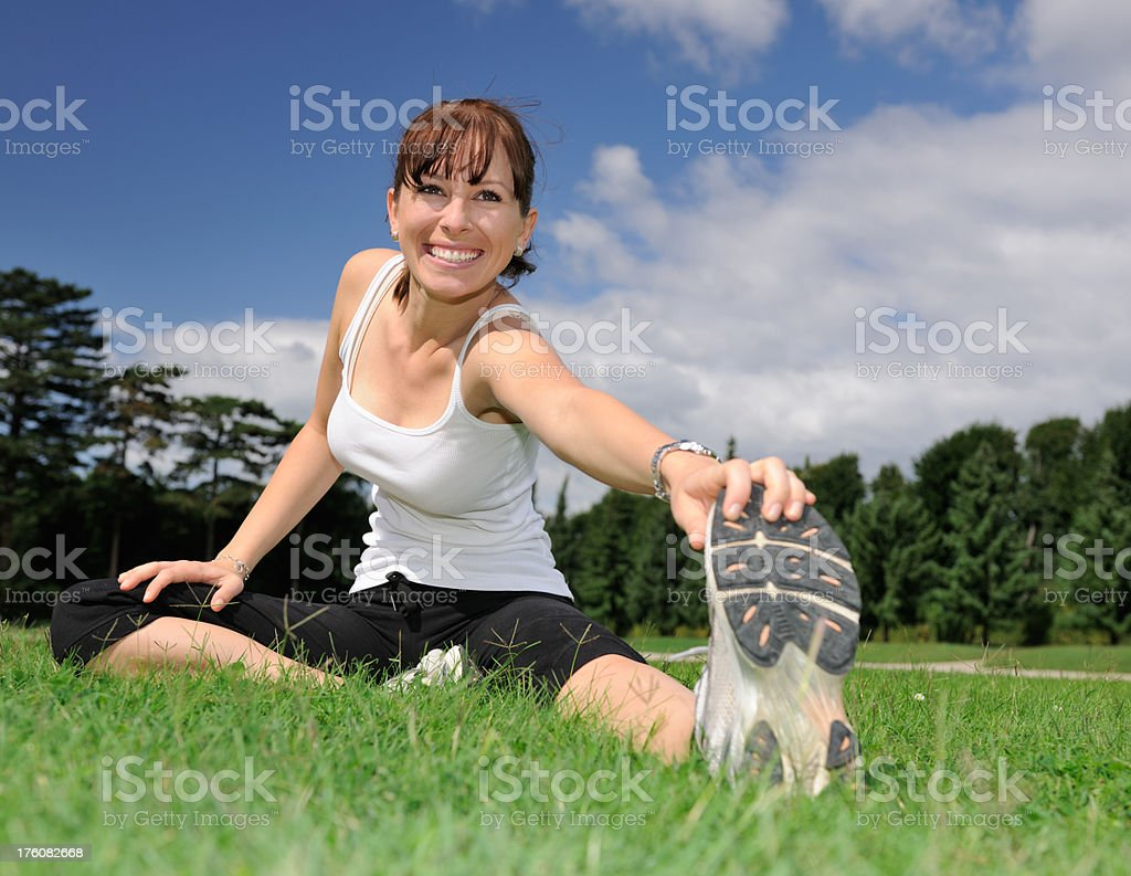Happy Woman Stretching Outdoor in a Meadow,  Leisure Activity (XXXL) royalty-free stock photo