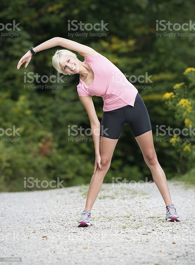 Happy Woman Stretching Outdoor, Sport Outfit royalty-free stock photo