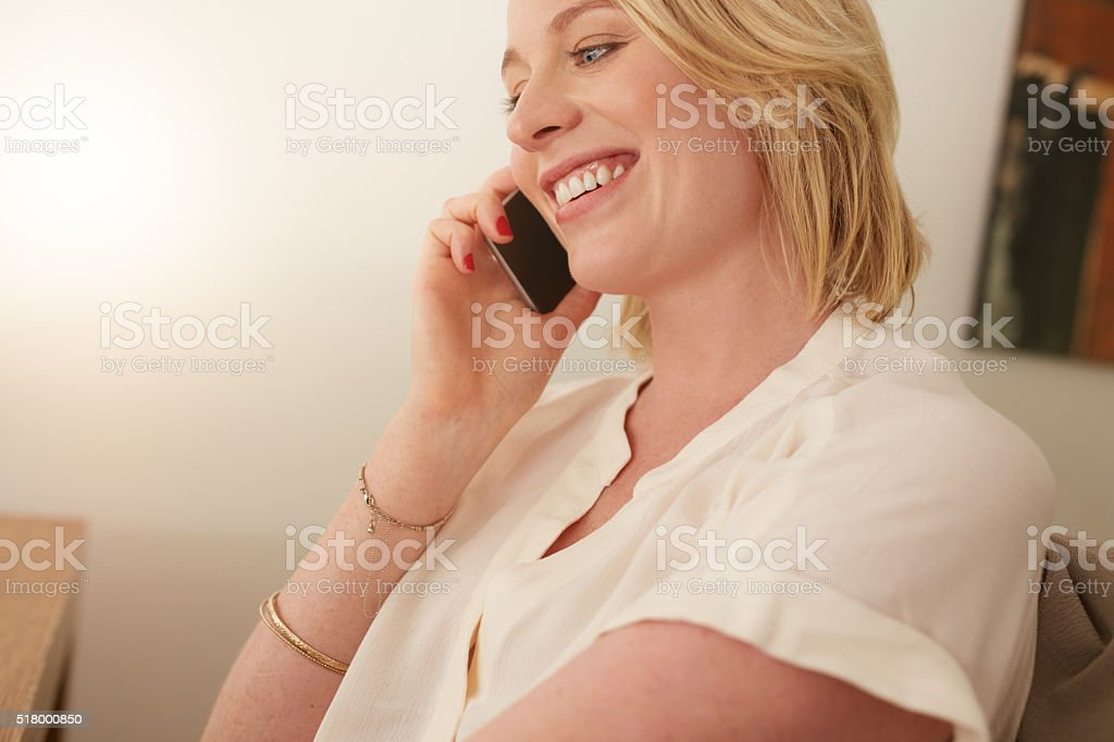 Happy woman talking on mobile phone stock photo