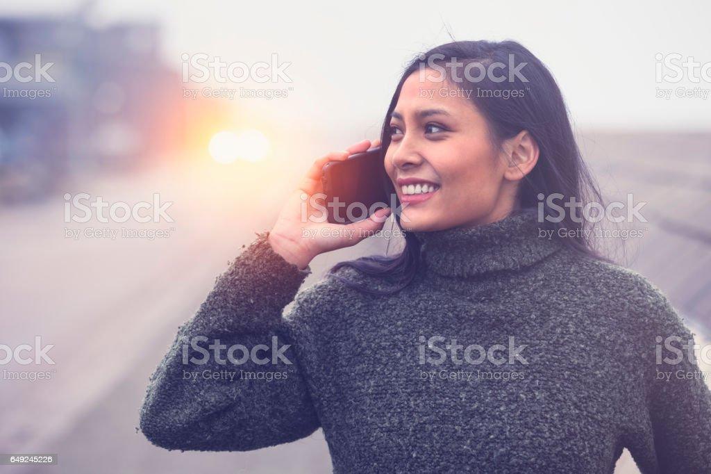 Happy woman talking smartphone, Helsingborg, Sweden stock photo
