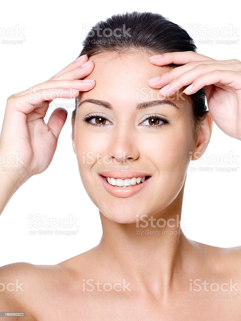 Happy woman touching her forehead stock photo