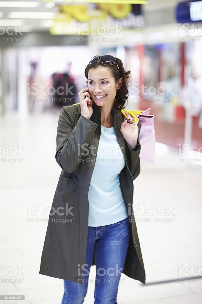 Happy woman using mobile phone royalty-free stock photo