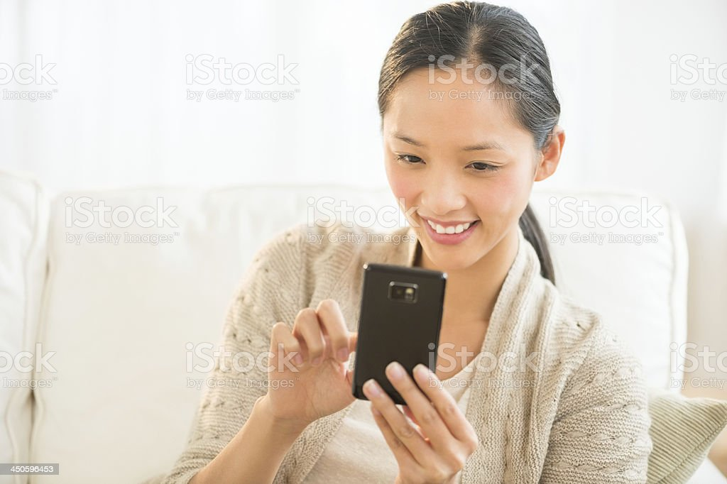 Happy Woman Using Smart Phone royalty-free stock photo