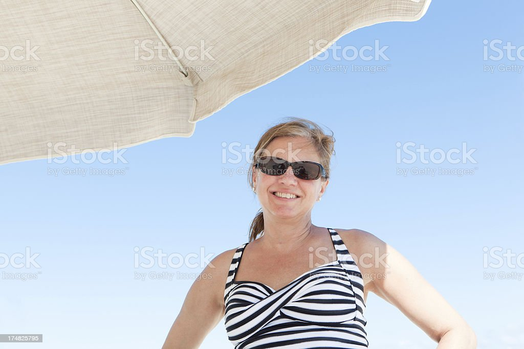 Happy Woman Vacationing in a Beach royalty-free stock photo