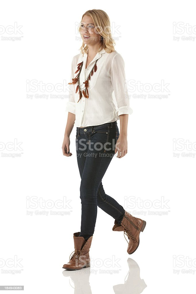 Happy woman walking stock photo