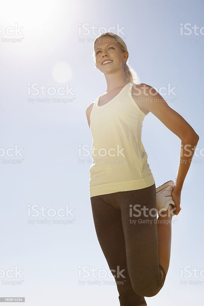 Happy woman warming up before a run royalty-free stock photo