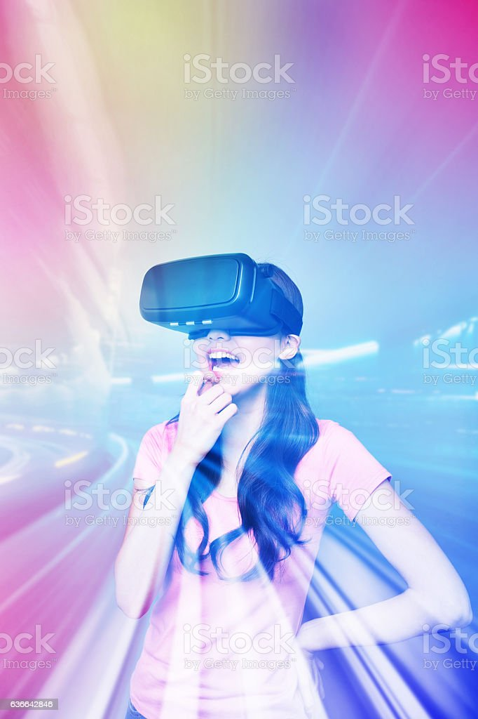 Happy woman watching virtual reality stock photo