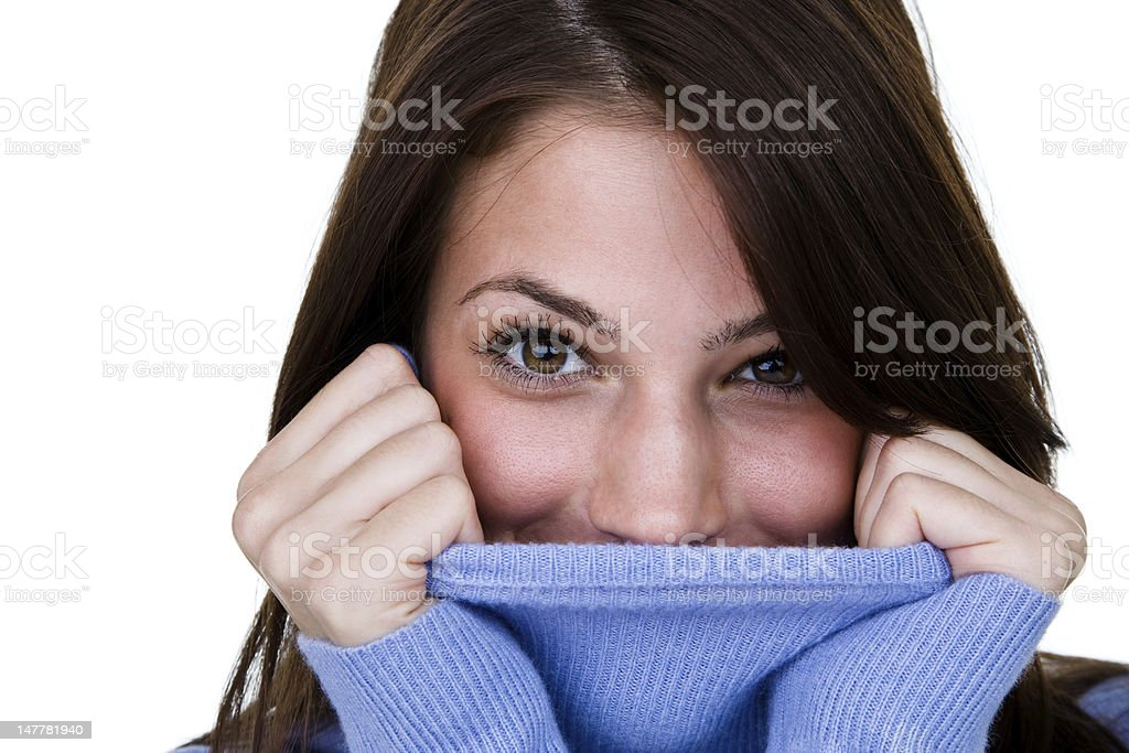 Happy woman wearing a turtleneck sweater royalty-free stock photo