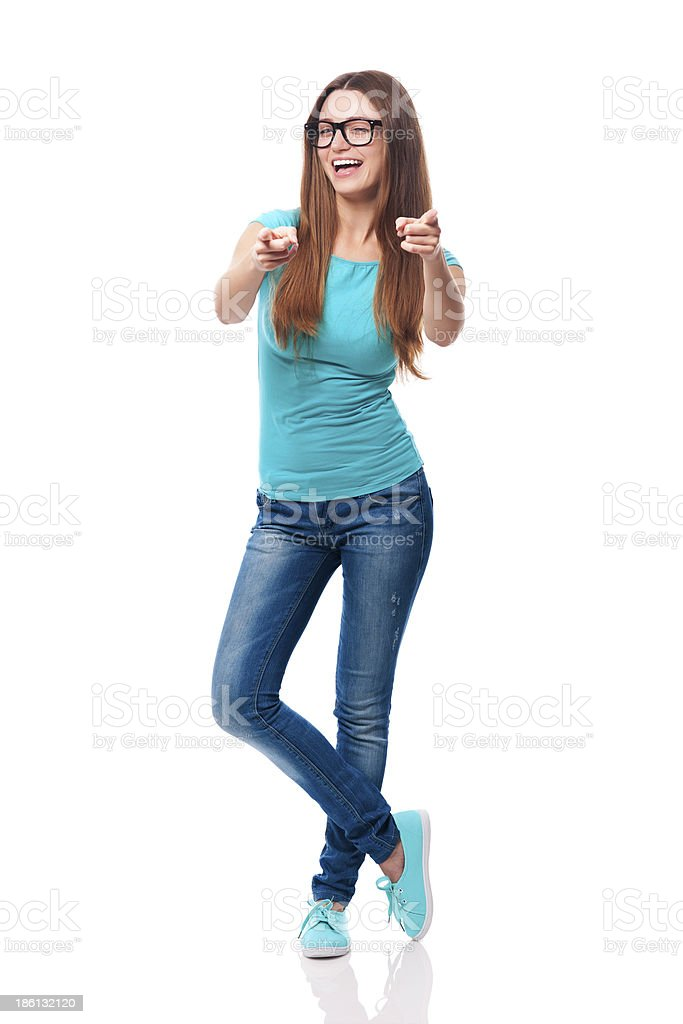 Happy woman winking and showing in camera side royalty-free stock photo