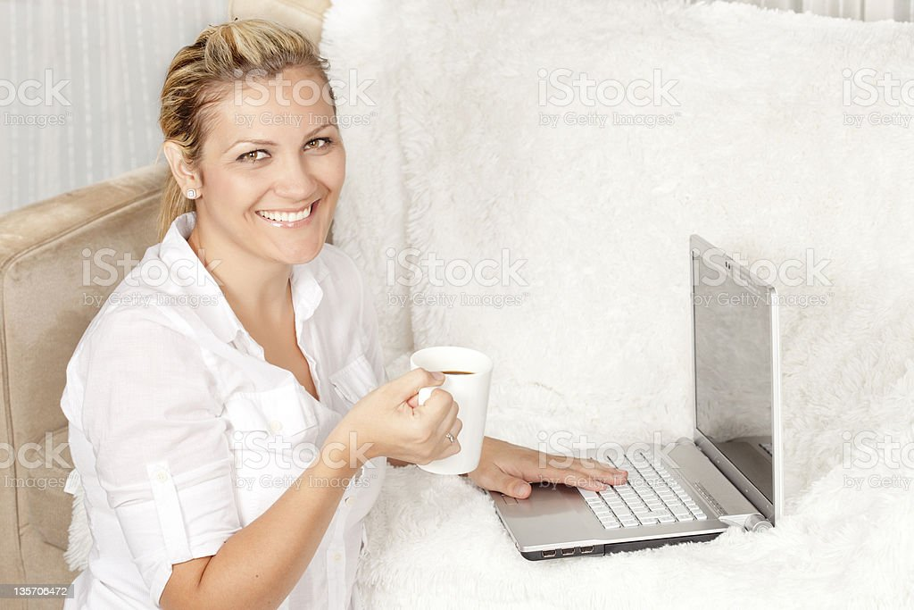 Happy woman with a laptop royalty-free stock photo