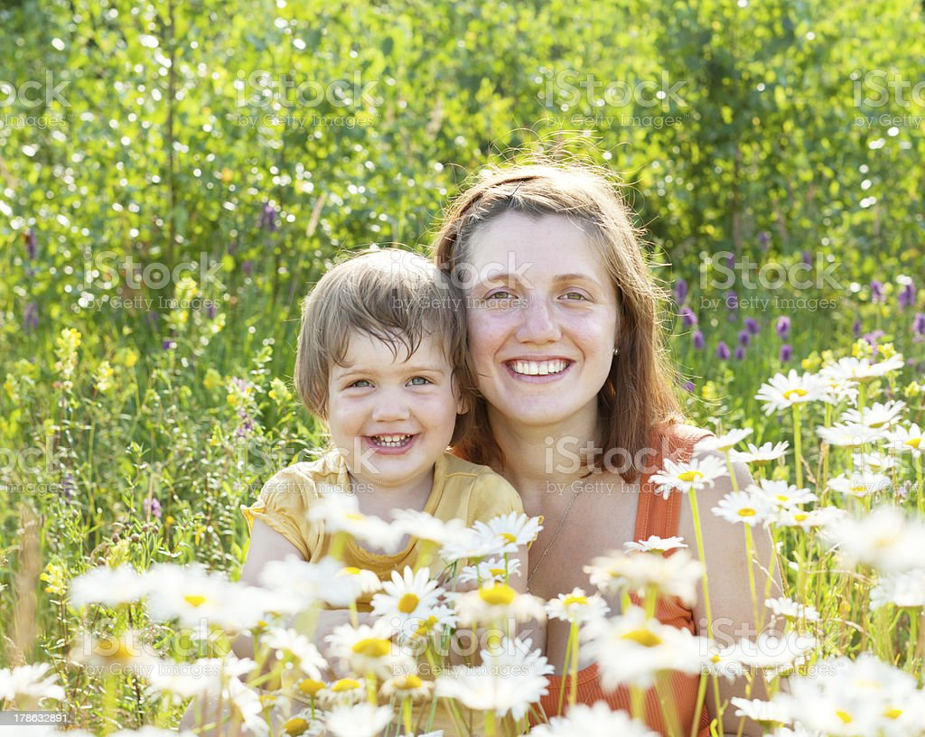 happy woman with baby in daisy plant royalty-free stock photo
