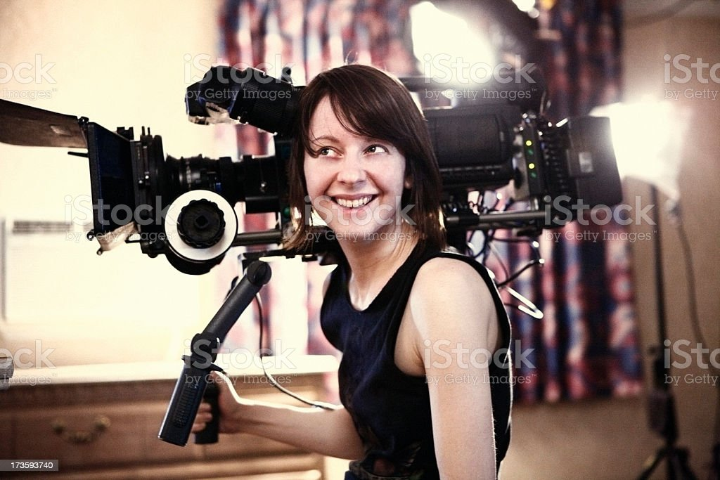 Happy Woman with Camera royalty-free stock photo