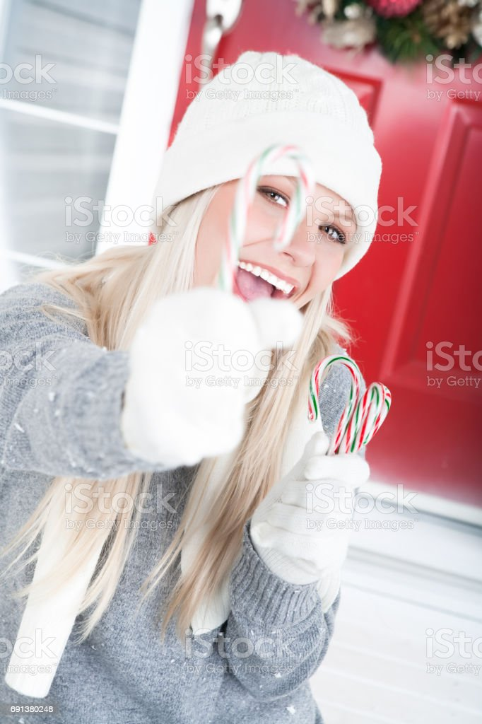 Happy woman with candy canes stock photo
