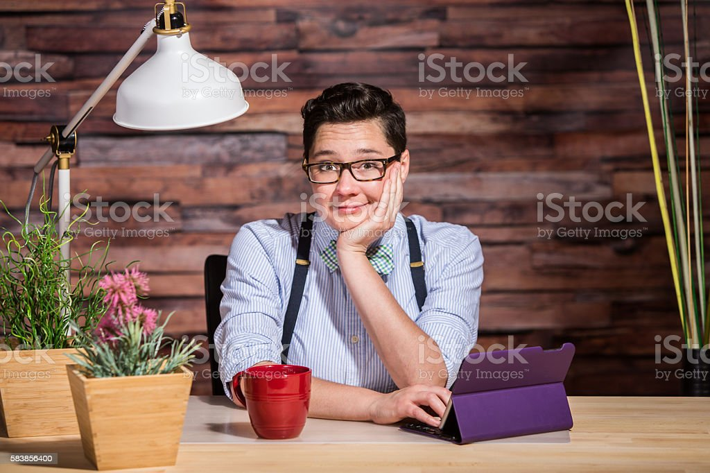 Happy Woman with Chin in Hand stock photo