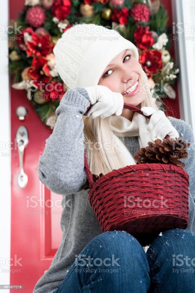Happy woman with Christmas pinecones stock photo
