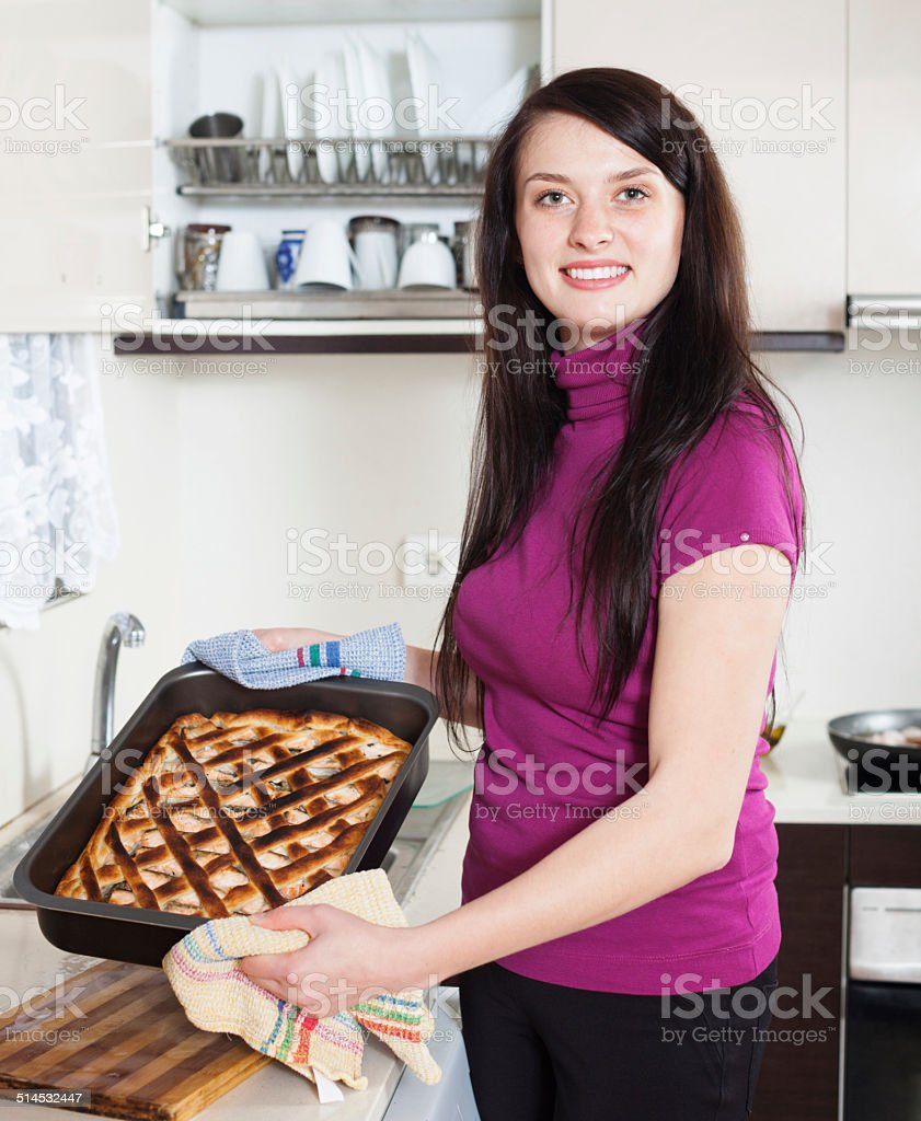 Happy woman with cooked  pie stock photo