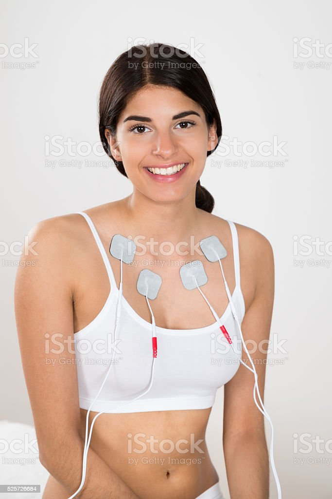 Happy Woman With Electrodes On Her Chest stock photo