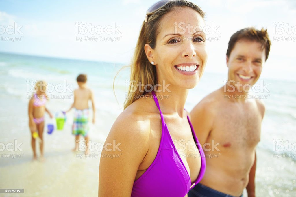 Happy woman with family in the background royalty-free stock photo