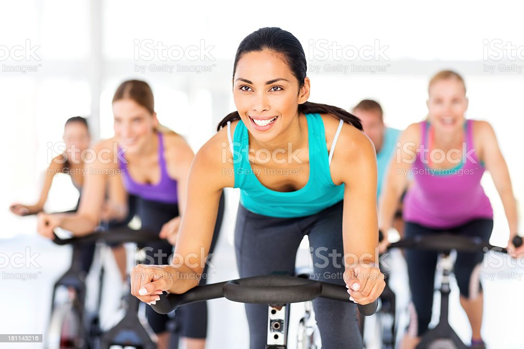 Happy Woman With Friends Spinning In Health Club stock photo