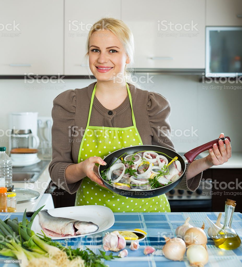 Happy woman with frying pan stock photo