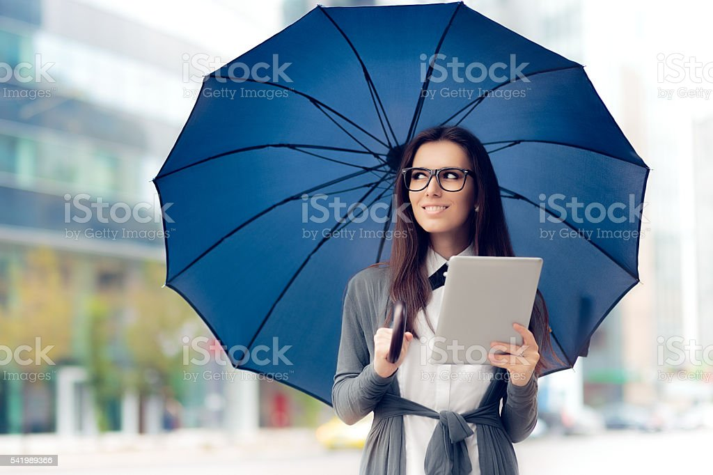 Happy Woman with Glasses, Tablet and Umbrella stock photo