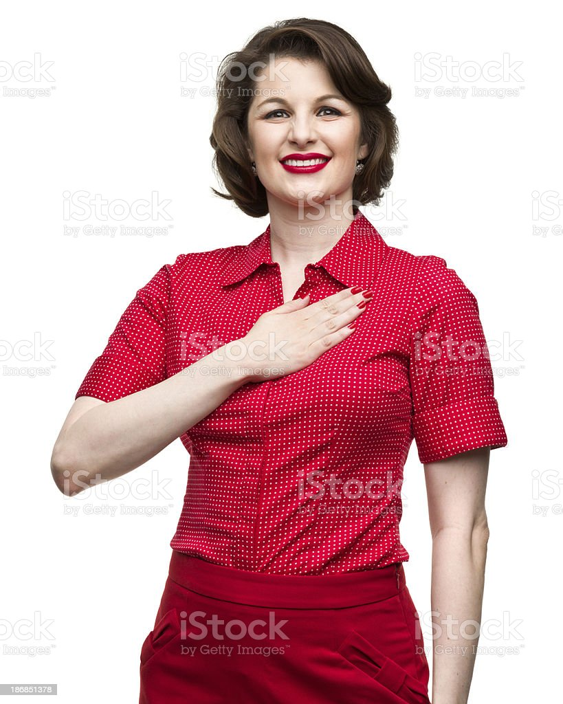 Happy Woman With Hand Over Heart stock photo