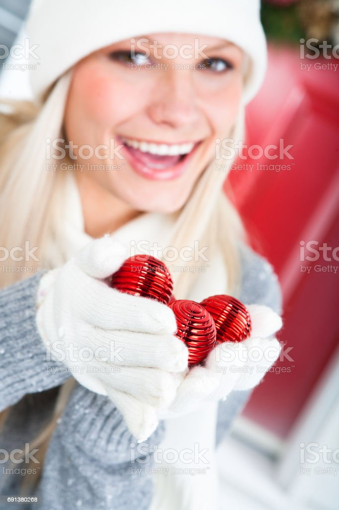 Happy woman with handful of bauble stock photo