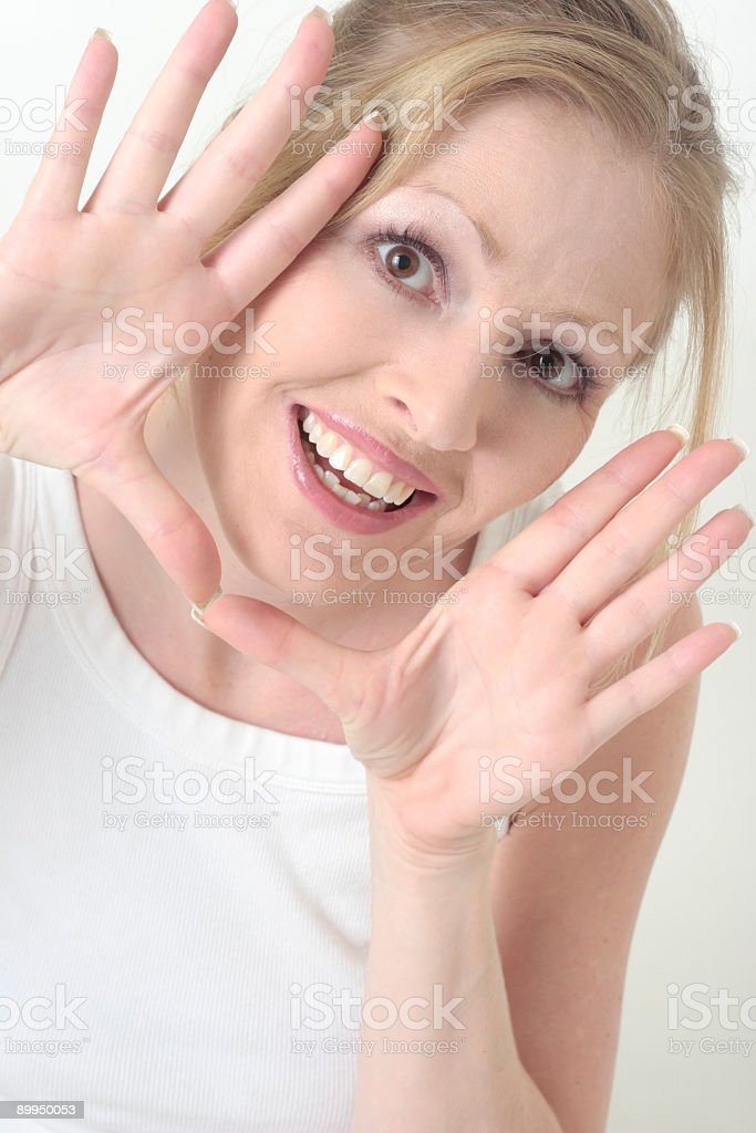 Happy woman with hands framing face royalty-free stock photo