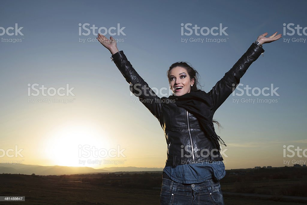 happy woman with hands in the air   celebrating outside stock photo