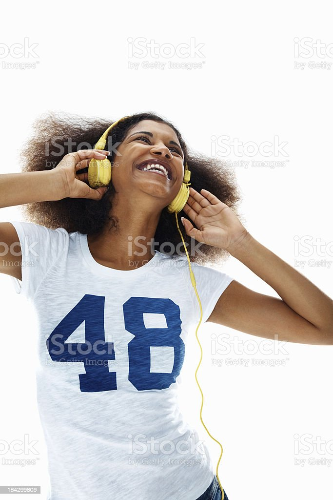 Happy woman with headphones on white background royalty-free stock photo