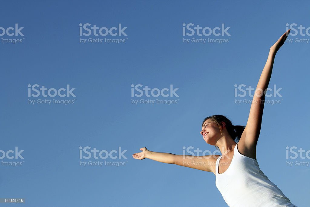 Happy woman with her arms wide open stock photo