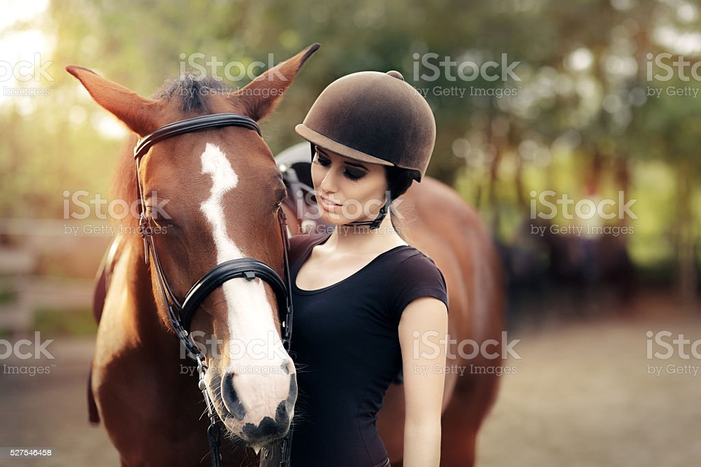 Happy Woman with her Horse stock photo
