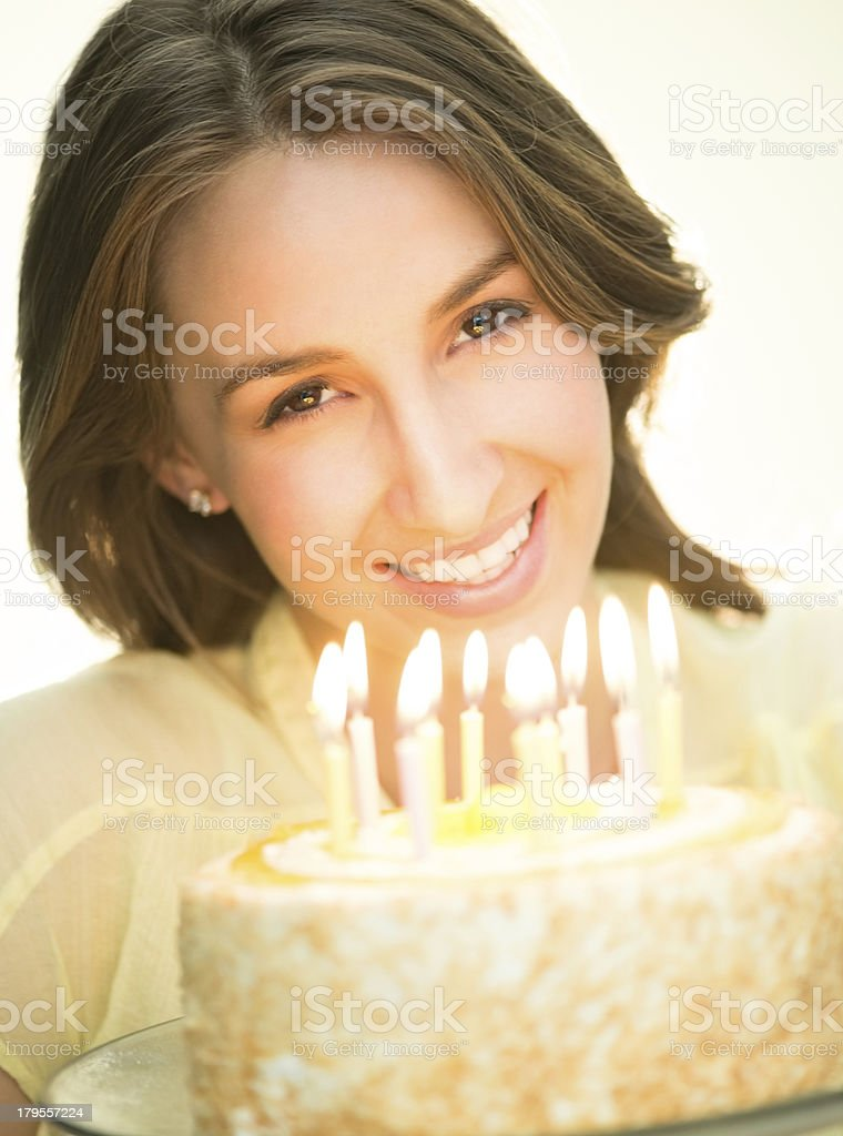 Happy Woman With Lit Candles On Cake royalty-free stock photo