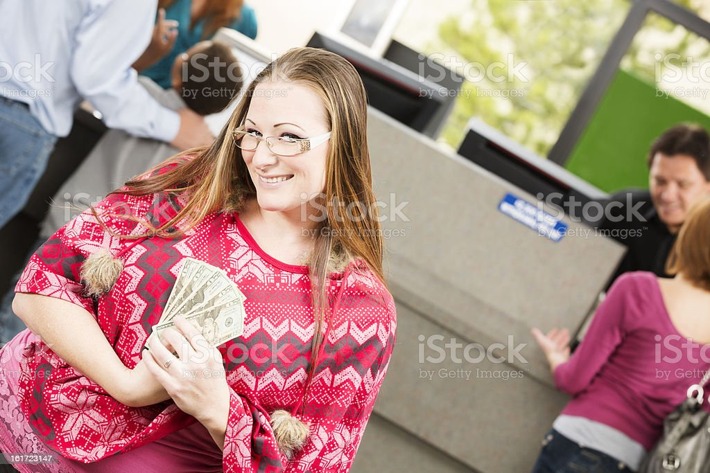 Happy woman with lots of money at the bank branch royalty-free stock photo