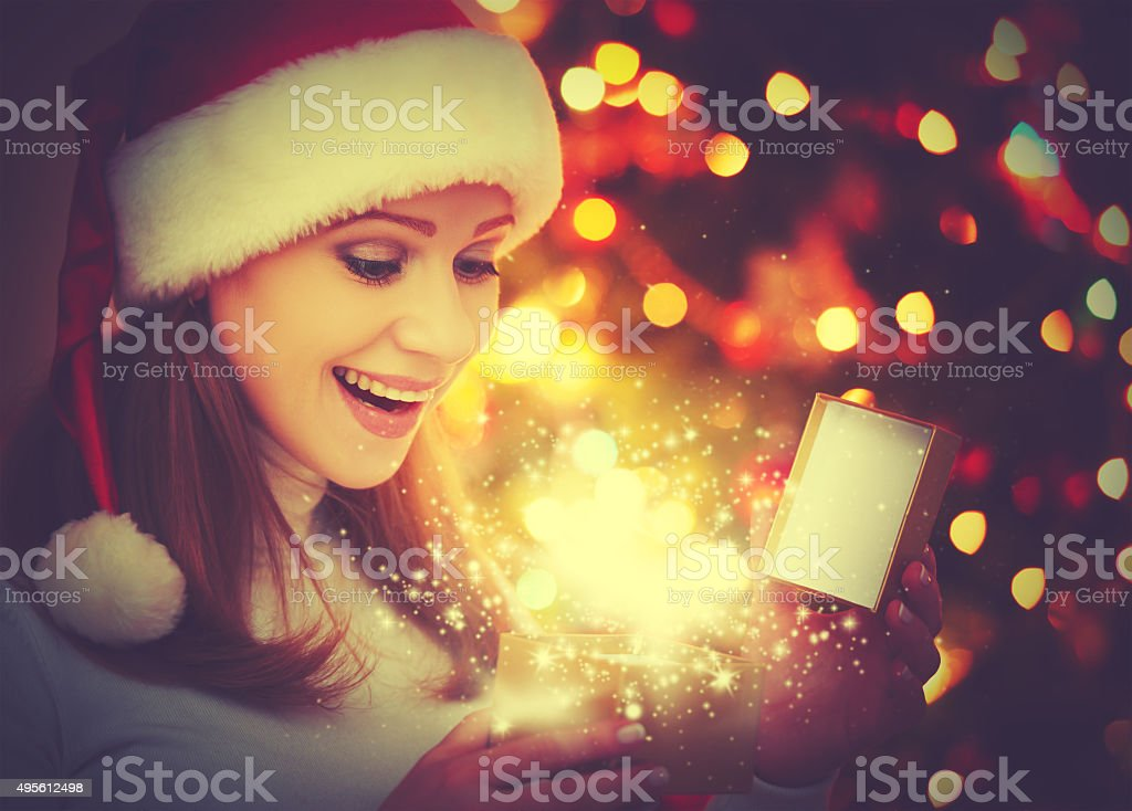 happy woman with magic Christmas  gifts stock photo