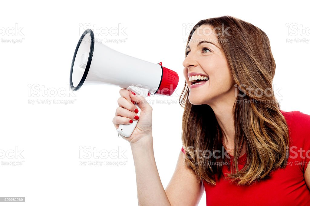 Happy woman with mega phone stock photo