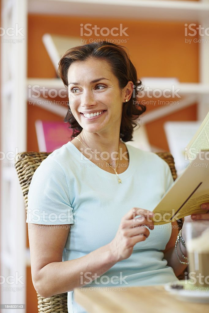 Happy woman with menu card royalty-free stock photo