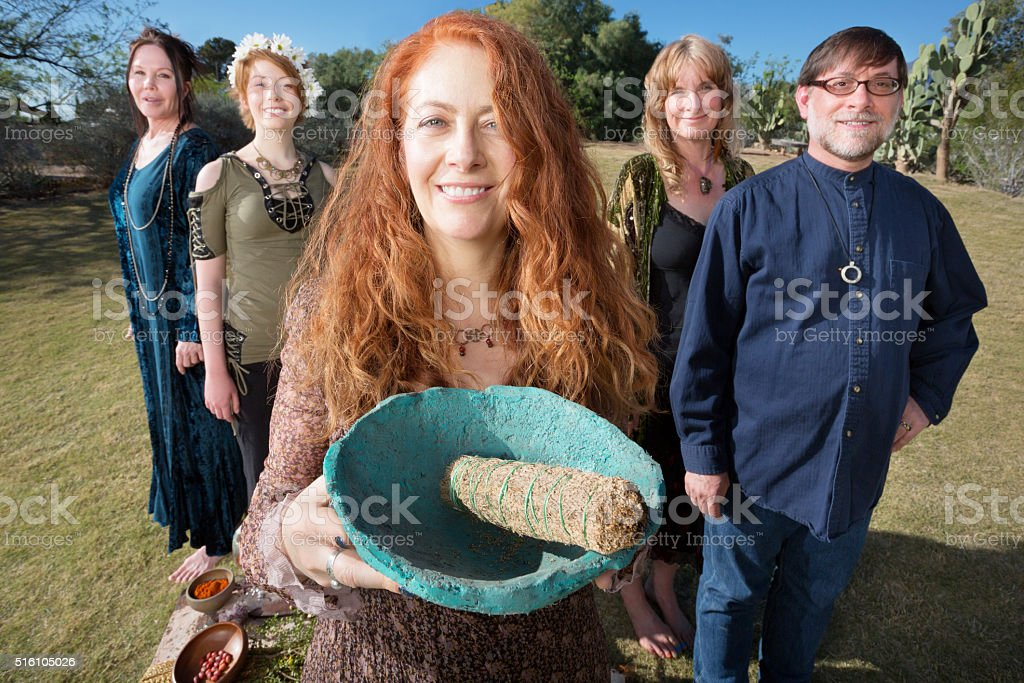 Happy Woman with Pagan Offering stock photo