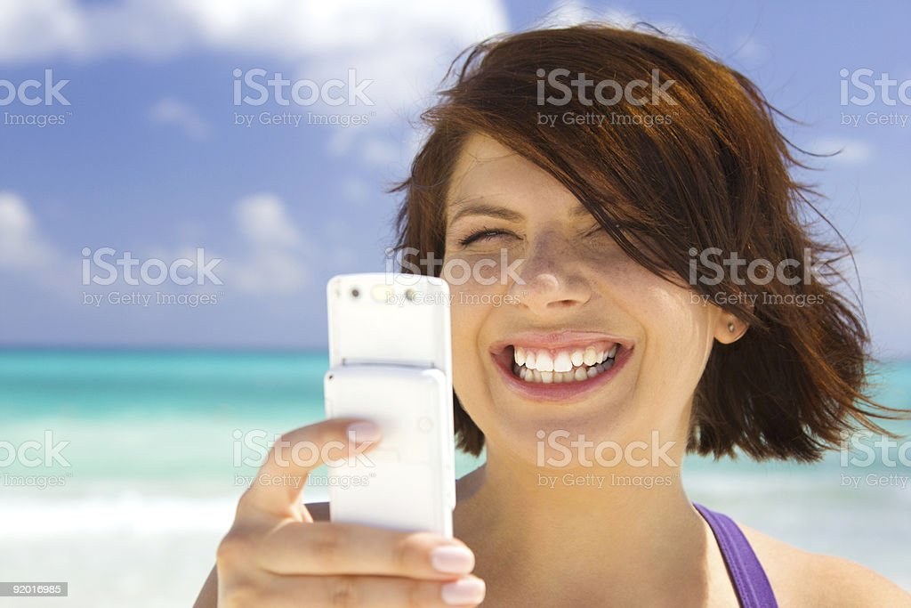 happy woman with phone on the beach royalty-free stock photo