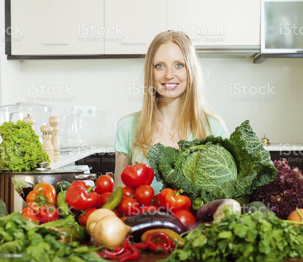 happy woman with pile of raw vegetables royalty-free stock photo