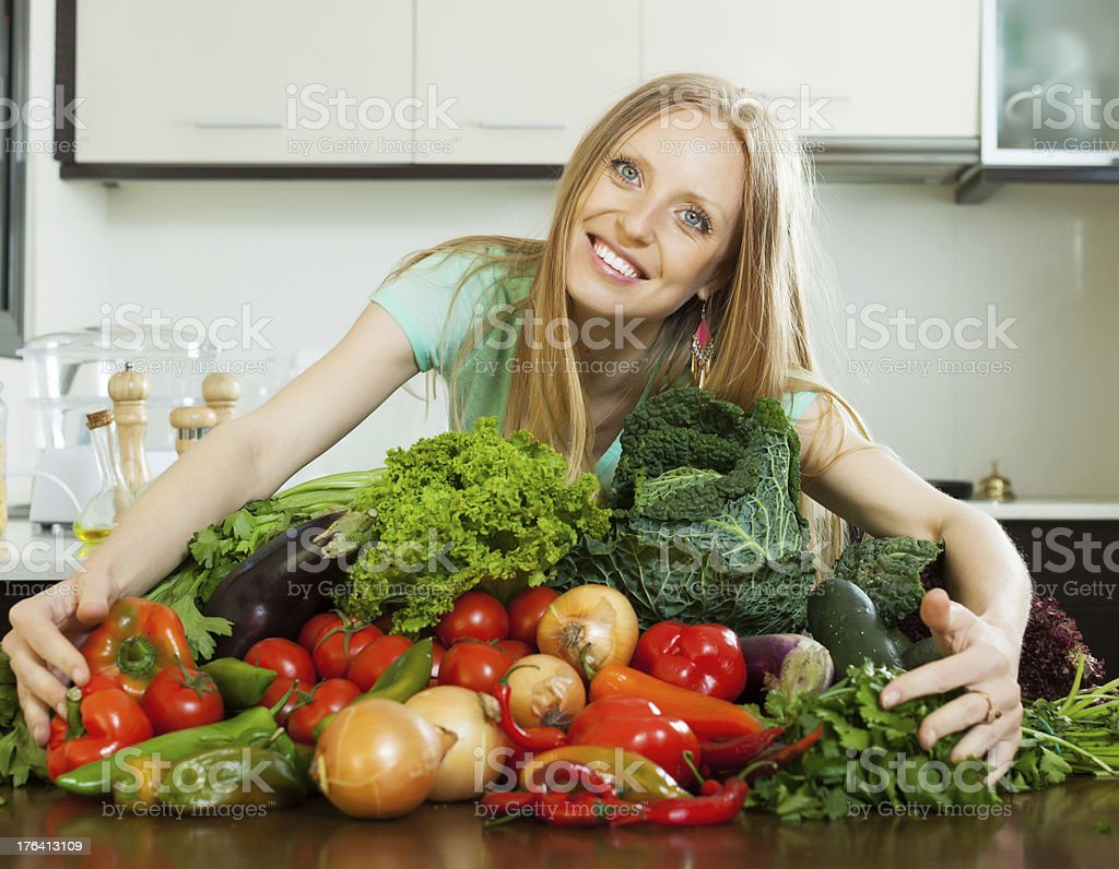 happy woman with pile of vegetables royalty-free stock photo