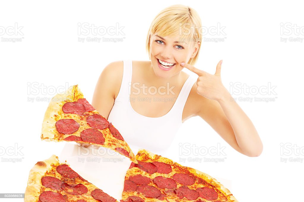 Happy woman with pizza stock photo