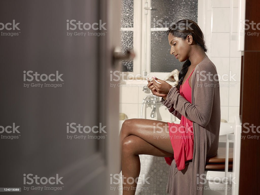 happy woman with pregnancy test kit stock photo