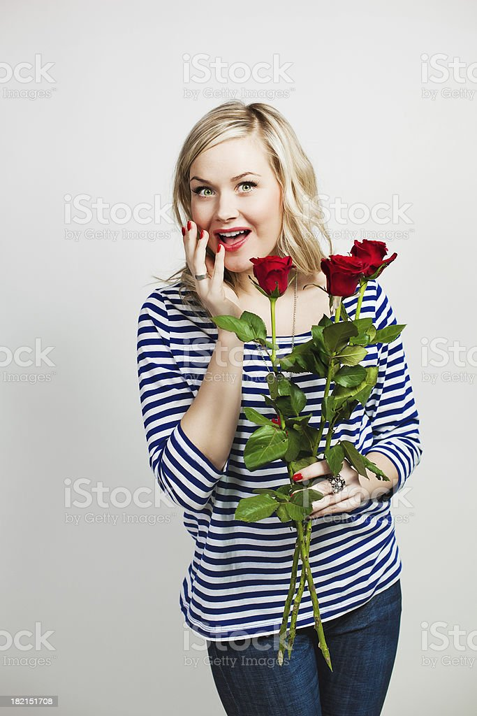 Happy woman with roses stock photo